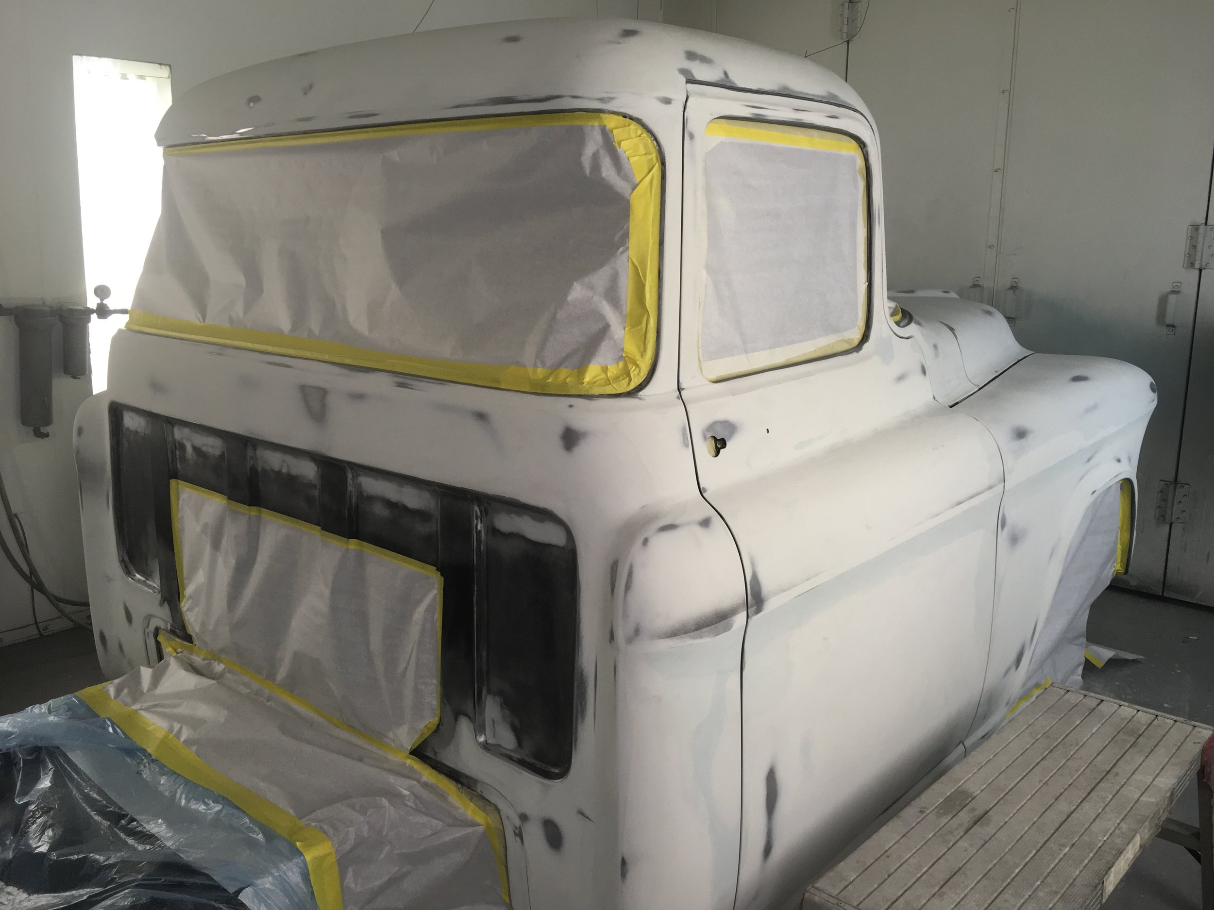 57 GMC truck taped and ready for prime