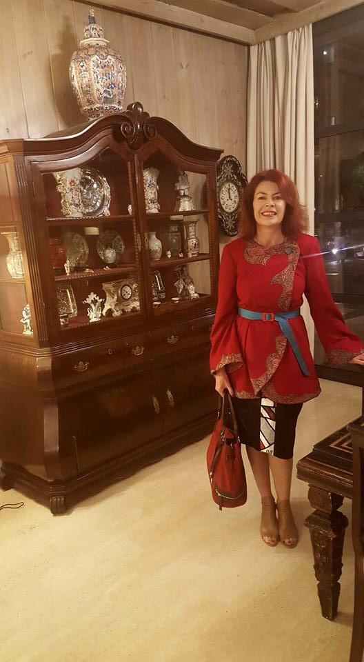 Lorelle wearing her Penelope Red Winter Coat in Spain...