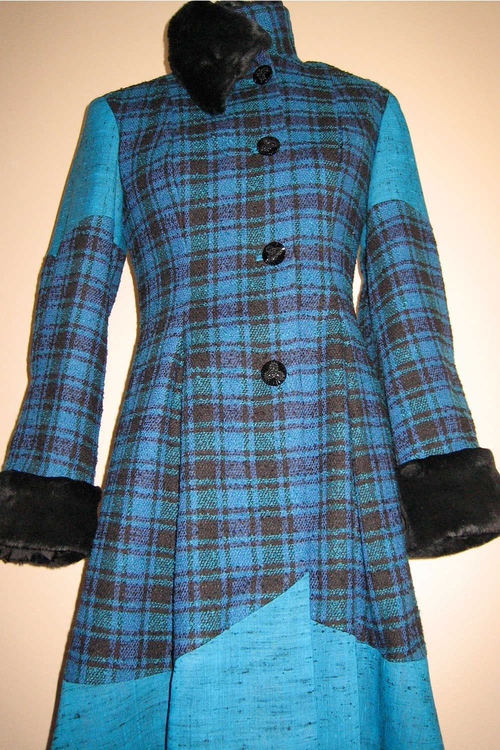 This Jade and Black Winter Coat was handmade using two very beautiful vintage fabrics, along with a faux fur trim in black.
