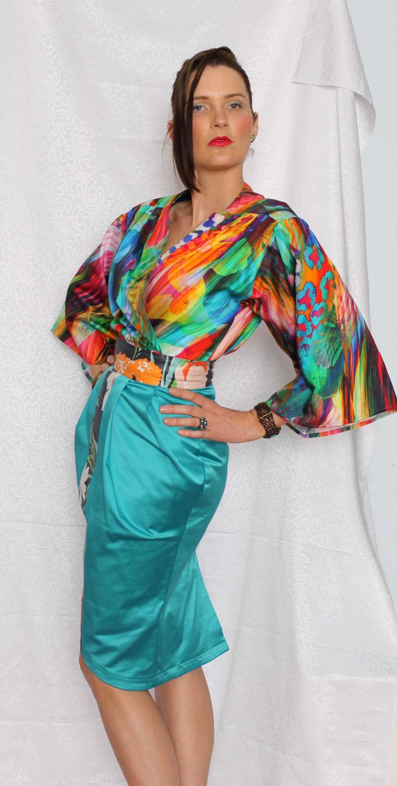 The Kaleidoscope Kimono worn with the jade pleated skirt.