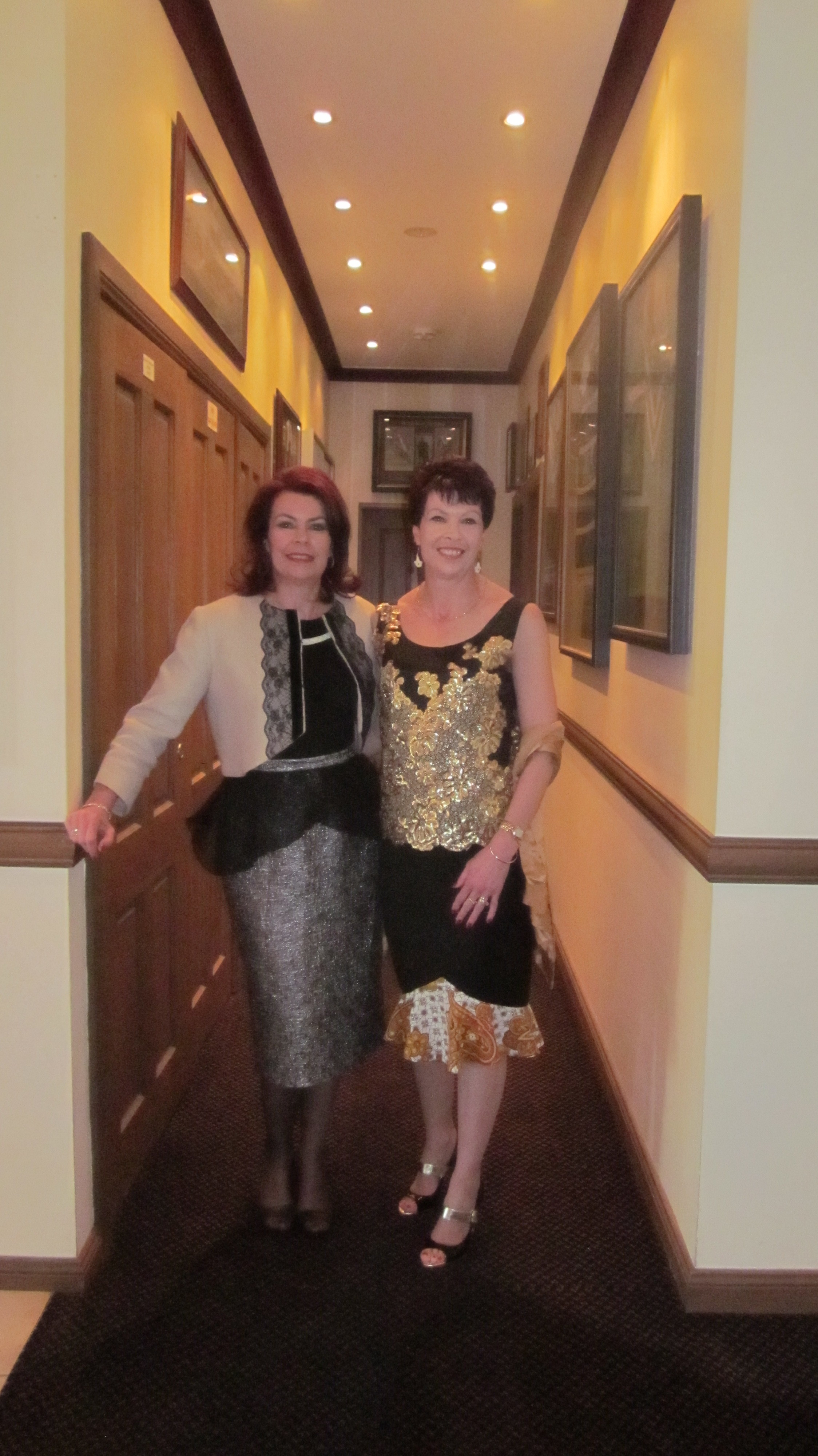 Lorelle wears the Gothic Coffee Bolero with the Silver Drama Skirt. Leanne wears the black and gold Cleopatra Blouse and the black and gold Tulip Skirt.