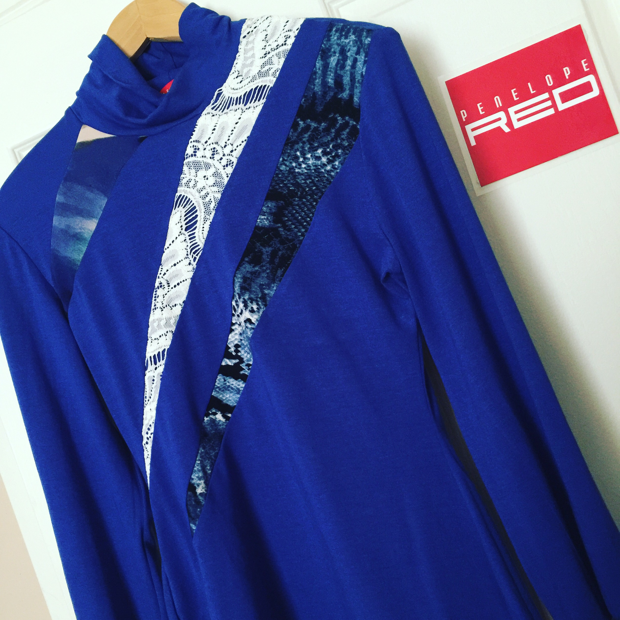 A bright blue version of my Jigsaw Skivvy, with a bright blue jersey knit body, and a cream lace, and printed contrast.