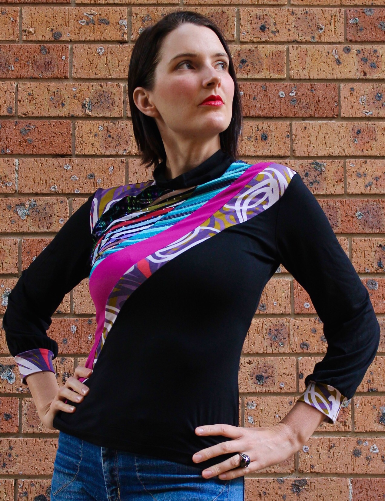 I am wearing my own one of a kind version of this Skivvy design. I love how these colours and prints work so well together but yet are so different! I am not a big fan of black, so if I make anything black for myself, it needs to have something with a bit of pizzazz! I think this fits the bill!