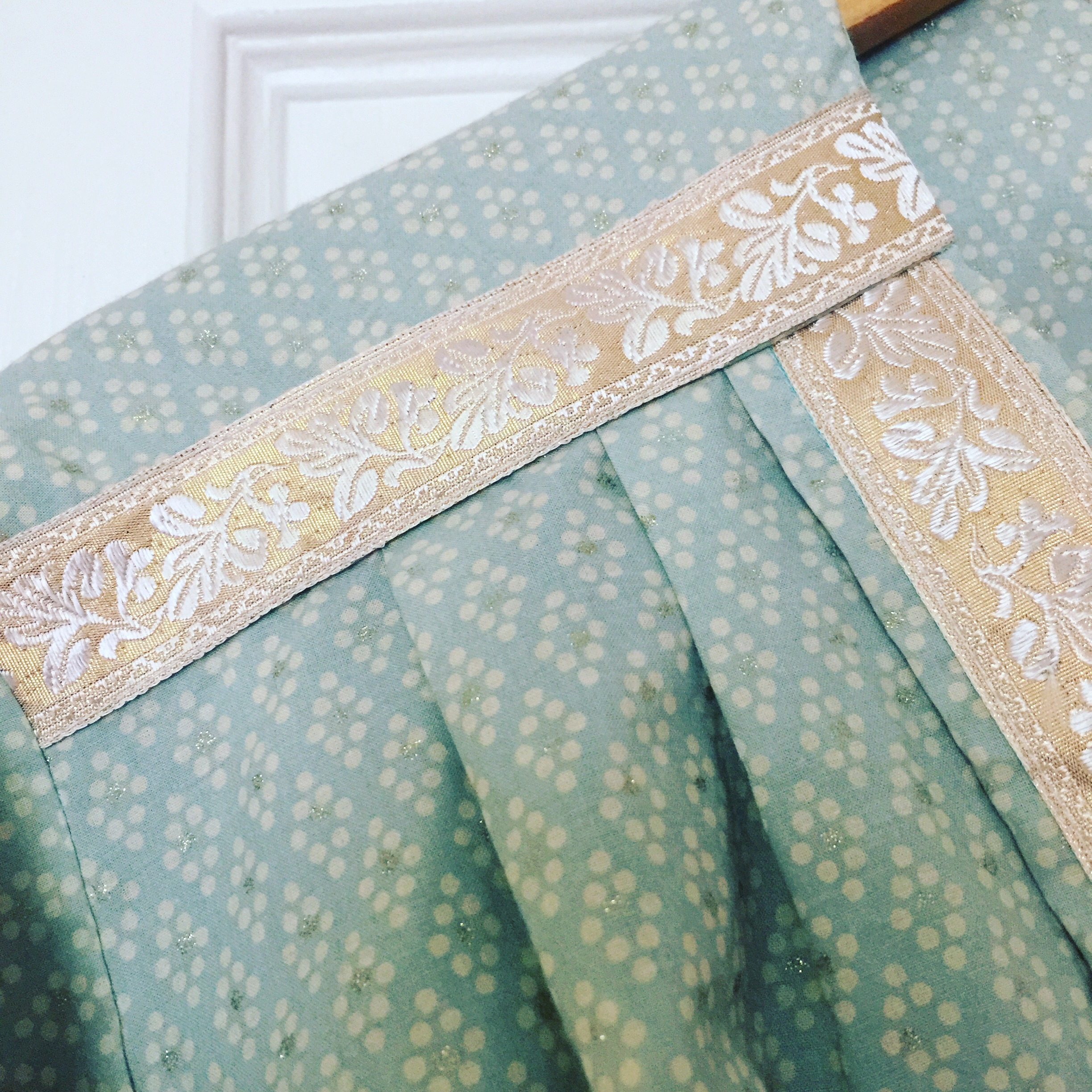 The Pastel Kimono, handmade from a mint green, cream and gold cotton fabric and a vintage pink and gold trim.