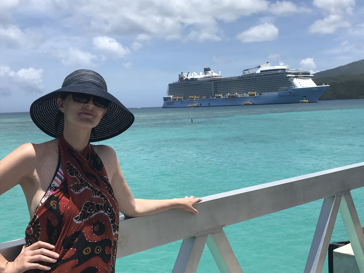 In this photo I am standing on the pier at Mystery Island, and you can see the Ovation of the Seas cruise shipping the back ground.