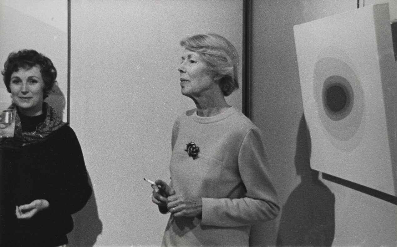 Lundeberg in front of one of her planet paintings, at David Stuart Gallery, 1970.