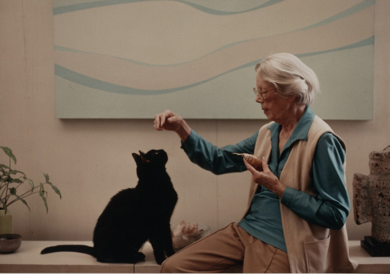 Lundeberg and her cat, Bran, in front of her 1968 work,  Swimmer , 1989.