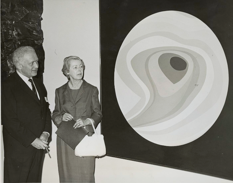 Bart Lytton and Helen Lundeberg in front of one of Lundeberg's planet paintings, circa 1960s.