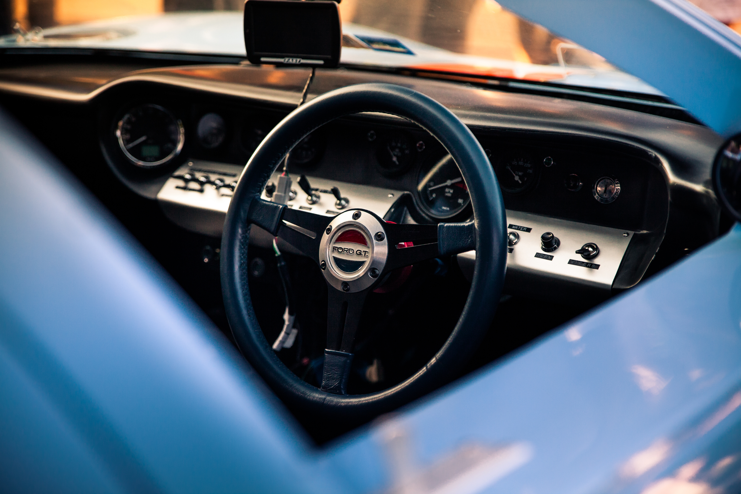 Almost like entering the cockpit of a fighter. The GT40 dash is lined with glimmering swithes and gauges.