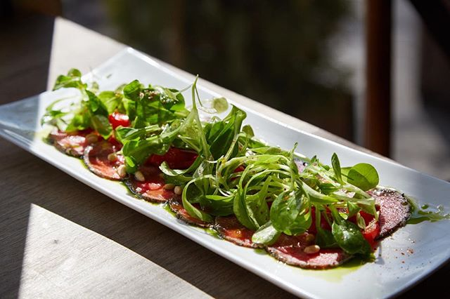 Add some Moroccan spice to your life!- Our new Beef Carpaccio is dressed in Moroccan spice, mache, pickled peppers, and pine nuts