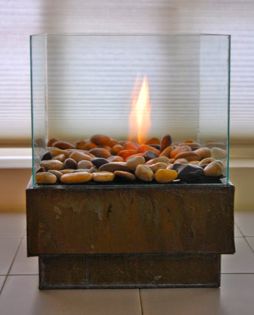 This is by far one of the coolest DIYs I've seen in a long time!!  You can make this very beautiful, very modern personal fire pit for less than $30.  The   Art of Doing Stuff   provides easy to follow instructions that include pictures.  Find the full tutorial  here!