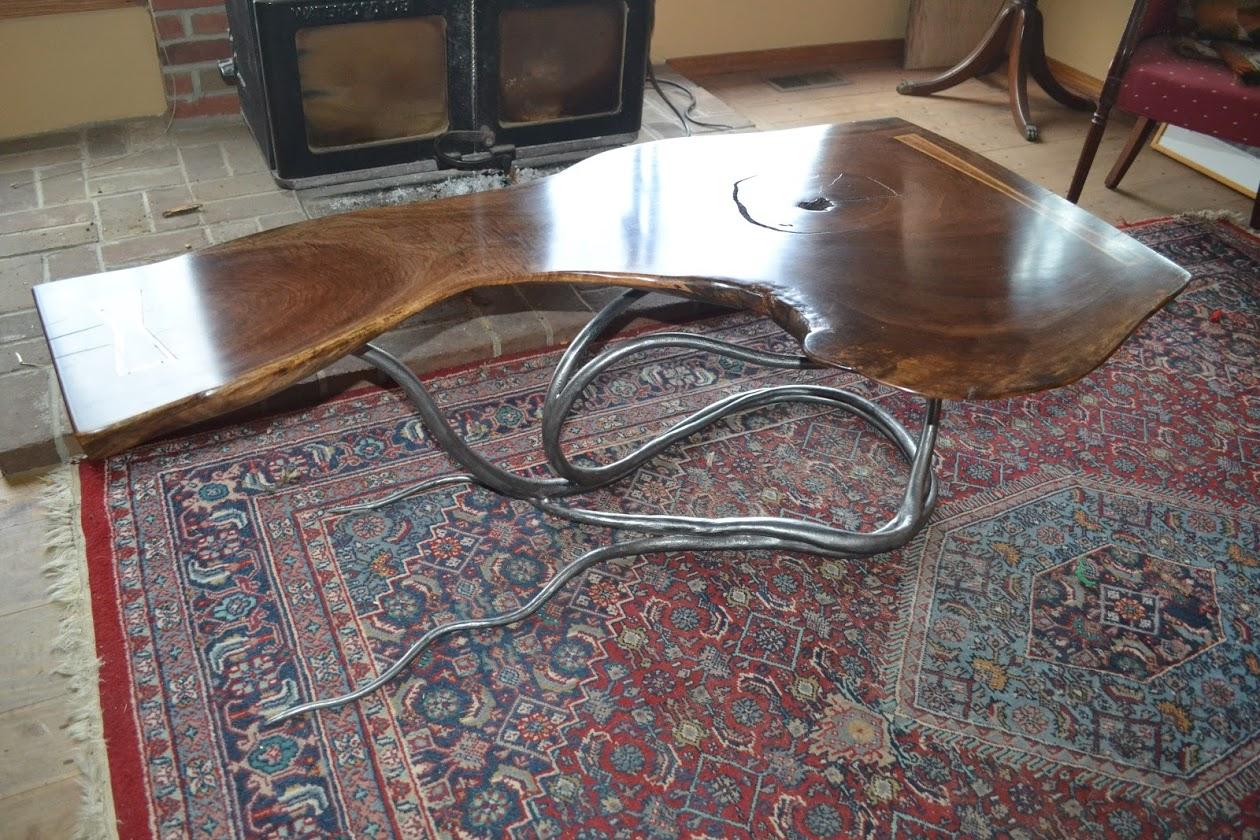 Coffee table. Live edge walnut slab, forged steel base