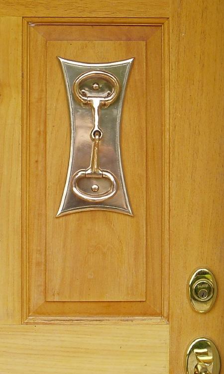 Bronze Snaffle Bit Door Knocker   Forged red and yellow bronze.