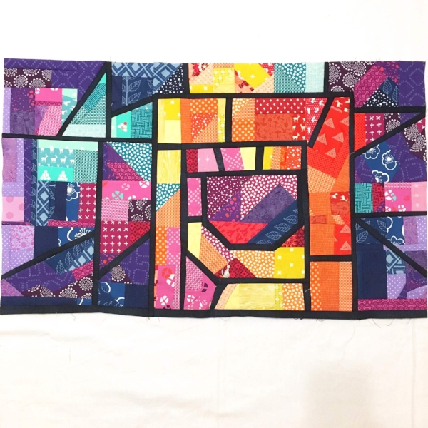 Let The Light In Quilt Top, minus three skinny borders on the top and sides.
