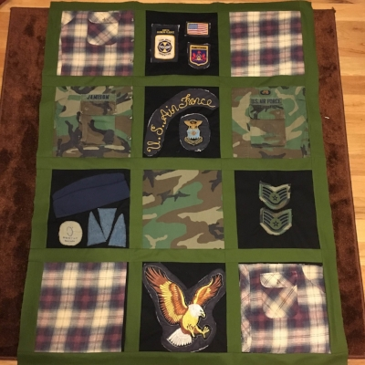 My most complicated quilt this week-- a memory quilt made of a bomber jacket, BDUs, a flannel shirt, and a few hats.