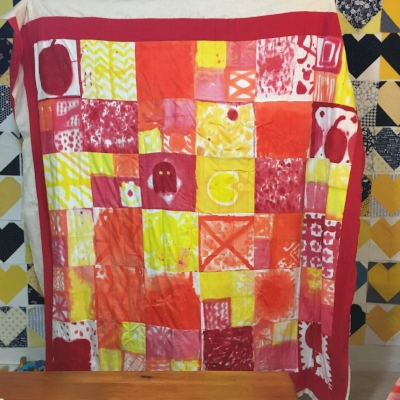 It's not trimmed or bound yet, but you can see it turned out pretty good. I used basic, (mostly) straight line quilting.