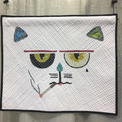 """""""My Cat is A Jerk"""" by Monica Solorio-Snow. I think Monica must know my cat Monte, because this is spot on. Monica used Melissa Averinos's making faces raw edge appliqué technique."""
