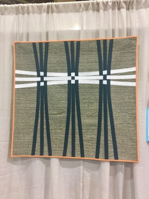 """""""Warp and Weft"""" by Cheryl Brickey. This quilt won 1st place in the 9-patch challenge, and it's easy to see why. I think this quilt is an excellent example of why we should exercise our creativity and seek inspiration beyond the specifics of our chosen field or craft."""
