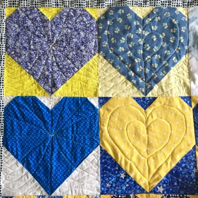 """I couldn't resist starting to practice a little on the #OperationSmiley Quilts. I keep reminding myself what Angela says: """"Practice makes progress."""" Only through spending time machine quilting will my lines become smoother and more accurate."""