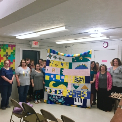 Greater Atlanta MQG and their charity quilt from this year's QuiltCon