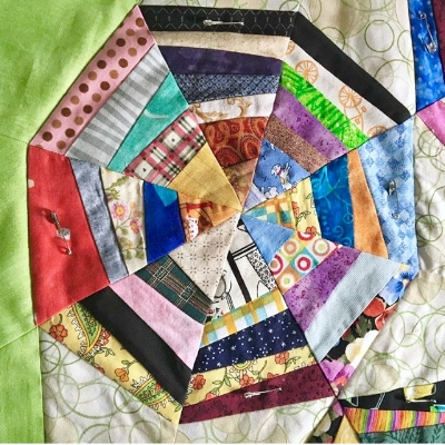 Spider Web quilt under the needle-- that we're hoping gets accepted to the East Cobb Quilter's Guild Show!