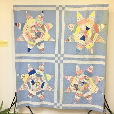 These scrappy stars are made with 1930s fabric but the quilting suggests the quilt may have been completed years after the top was pieced