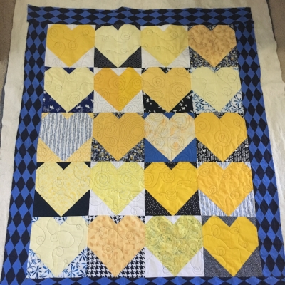 """Ironically, I haven't actually done any of this week's """"building block"""" repeat motifs on this quilt yet, but I enjoyed doing a walking foot spiral to spiral meander to loopy meander progression. I'm deciding between switchbacks and ribbon candy for the borders."""