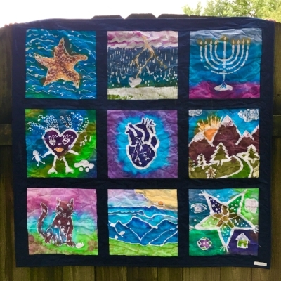 Customer Batik Quilt, Quilted with Aurifil Monofilament by HollyAnne Knight of String & Story