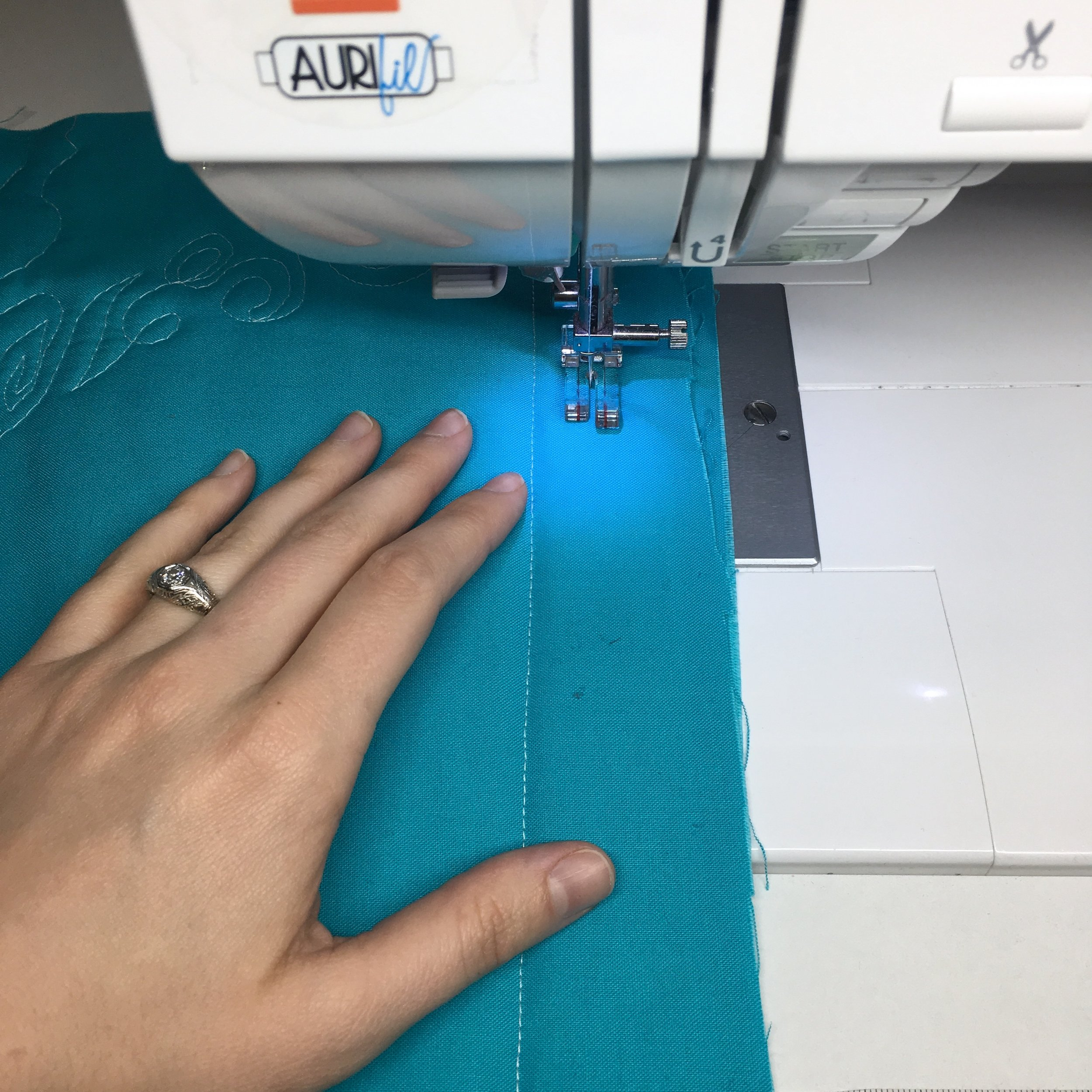 Take a few passes on a practice sandwich to check your tension and speed... Learn more about straight-line quilting by clicking through to this tutorial by HollyAnne Knight of String & Story
