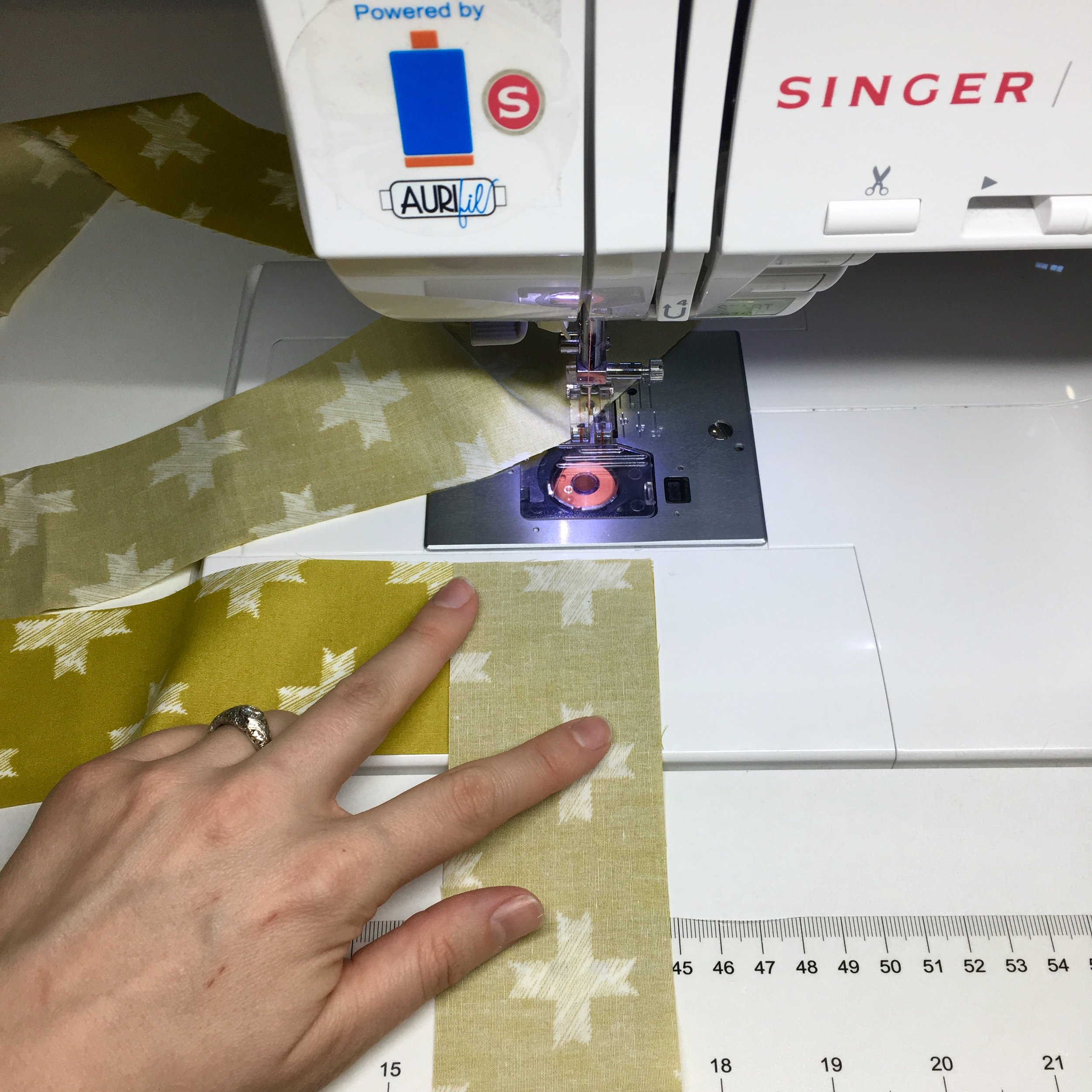 How to Bind a Quilt by Machine with HollyAnne Knight of String & Story -- Click through for all my binding tips and tricks!