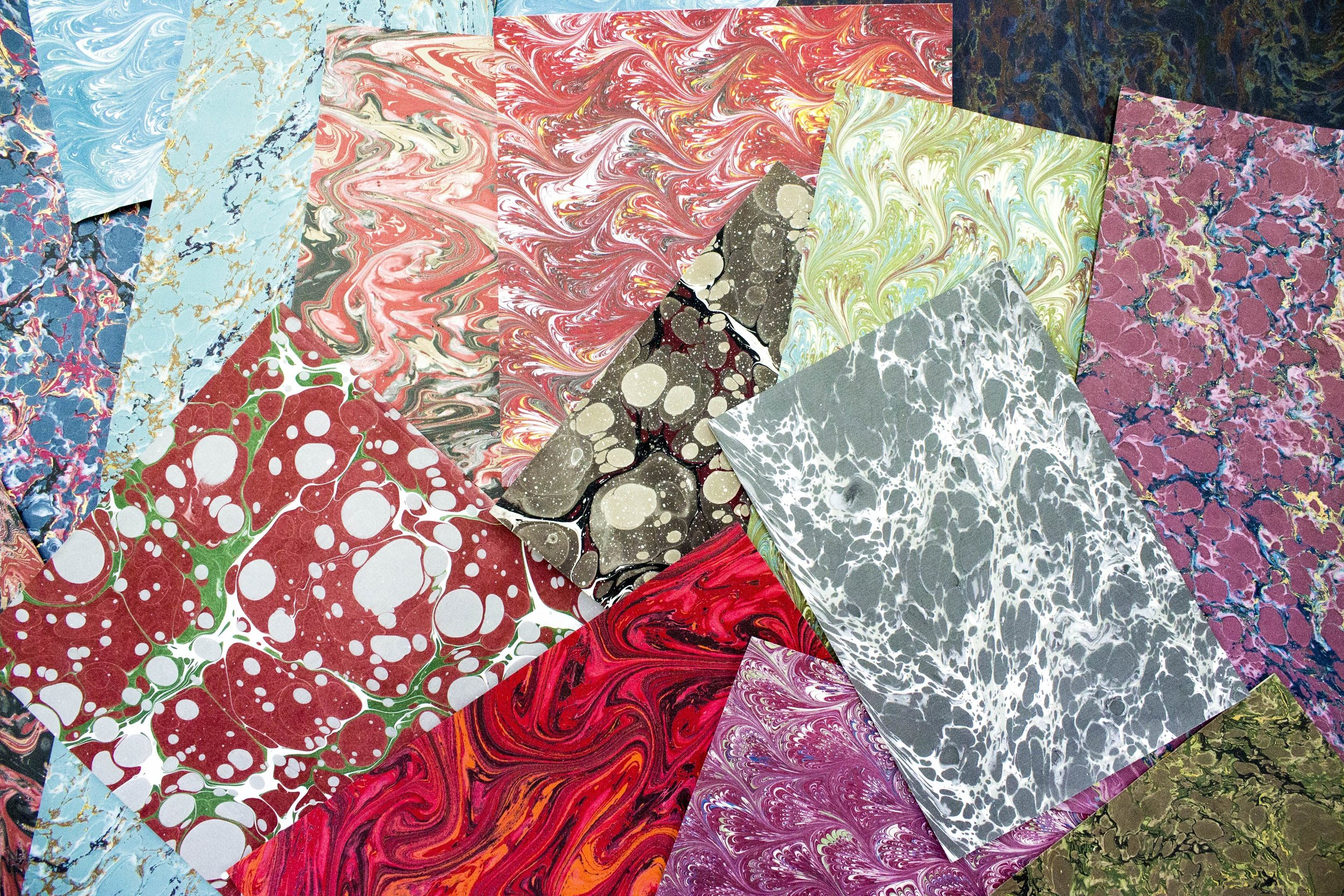 We stocka range of had and machine marbled papers.   Contact us  to see what we have available.