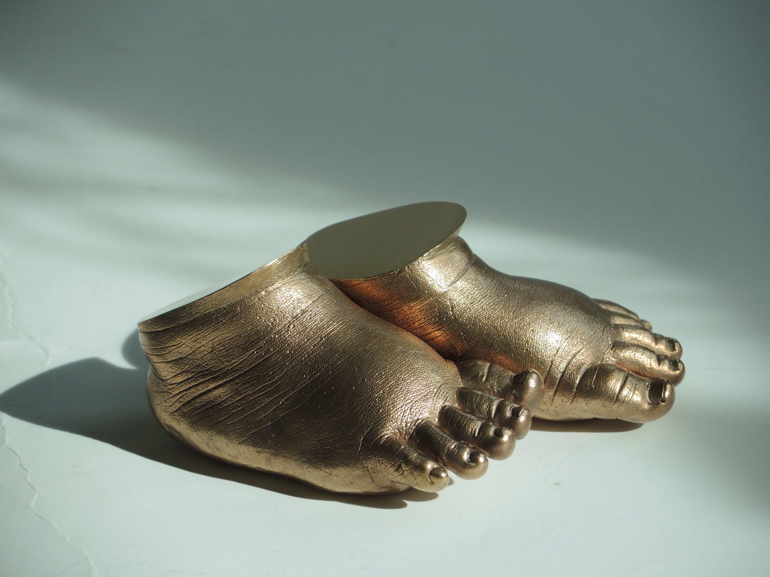 Bronze feet