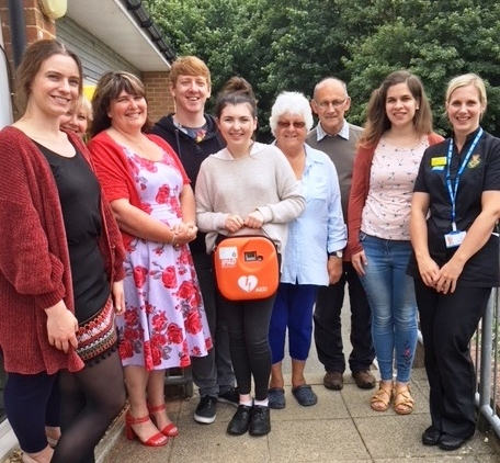 The Wight Strollers with the Head Teacher of St Thomas of Canterbury, Maggie Sanderson (third from left) and Louise Walker from IW NHS Trust Ambulance service.