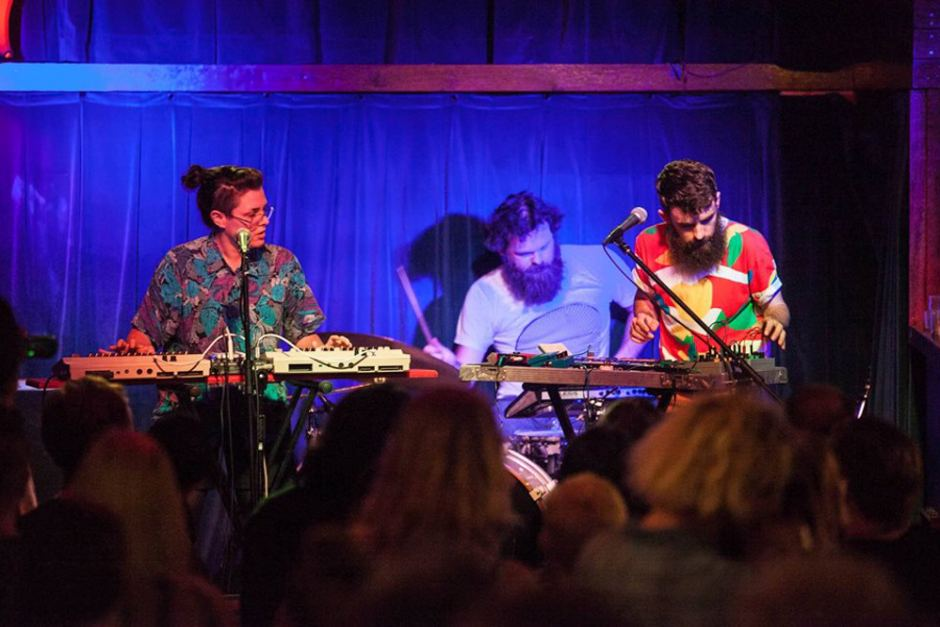 The Phoenix show how they use different interfaces within their music. Photo: Adam Thomas / ABC