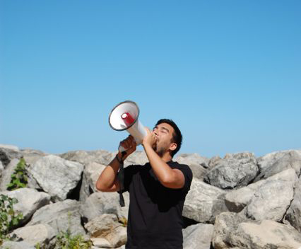 Alejandro T. Acierto, still of performance from 'Water Music on the Beach', Vocal performance with megaphone. curated by Tricia Van Eck,7 September 2014