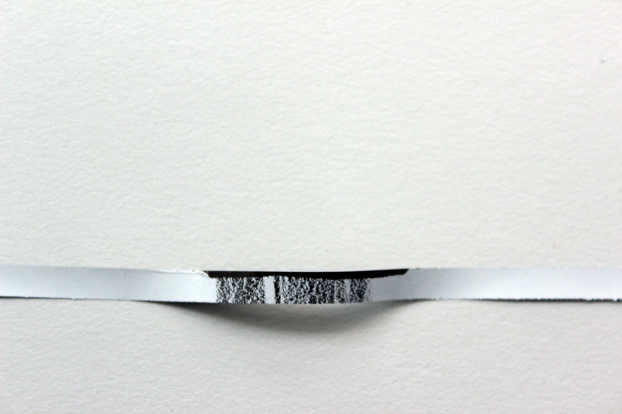 Alejandro T. Acierto, erasure (for Michael Brown) [working title], 2014 white correction tape on magnetic tape encased in a cassette art of a series of works for cassette.