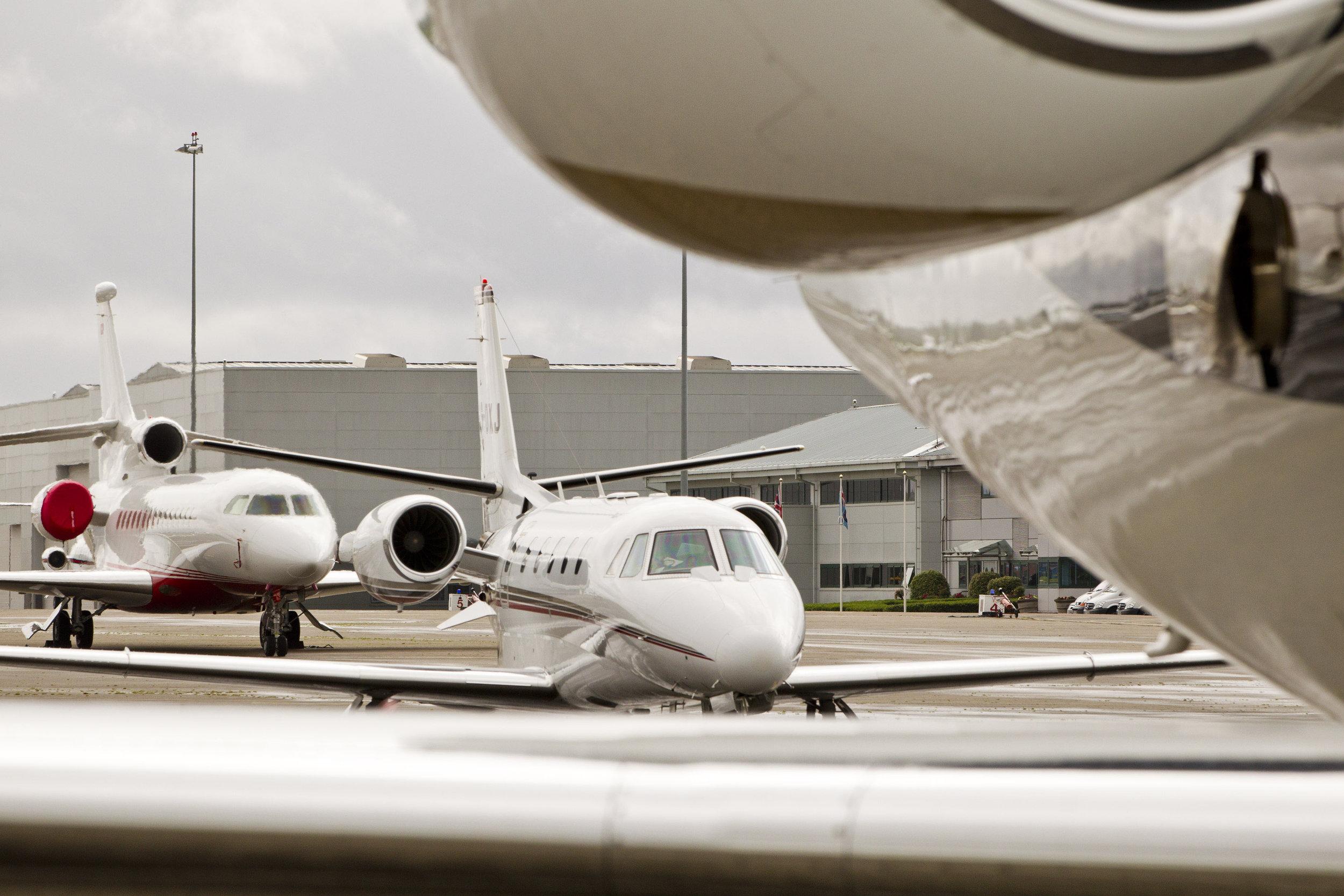 Business Jets line up for take off at RAF Northolt.jpg