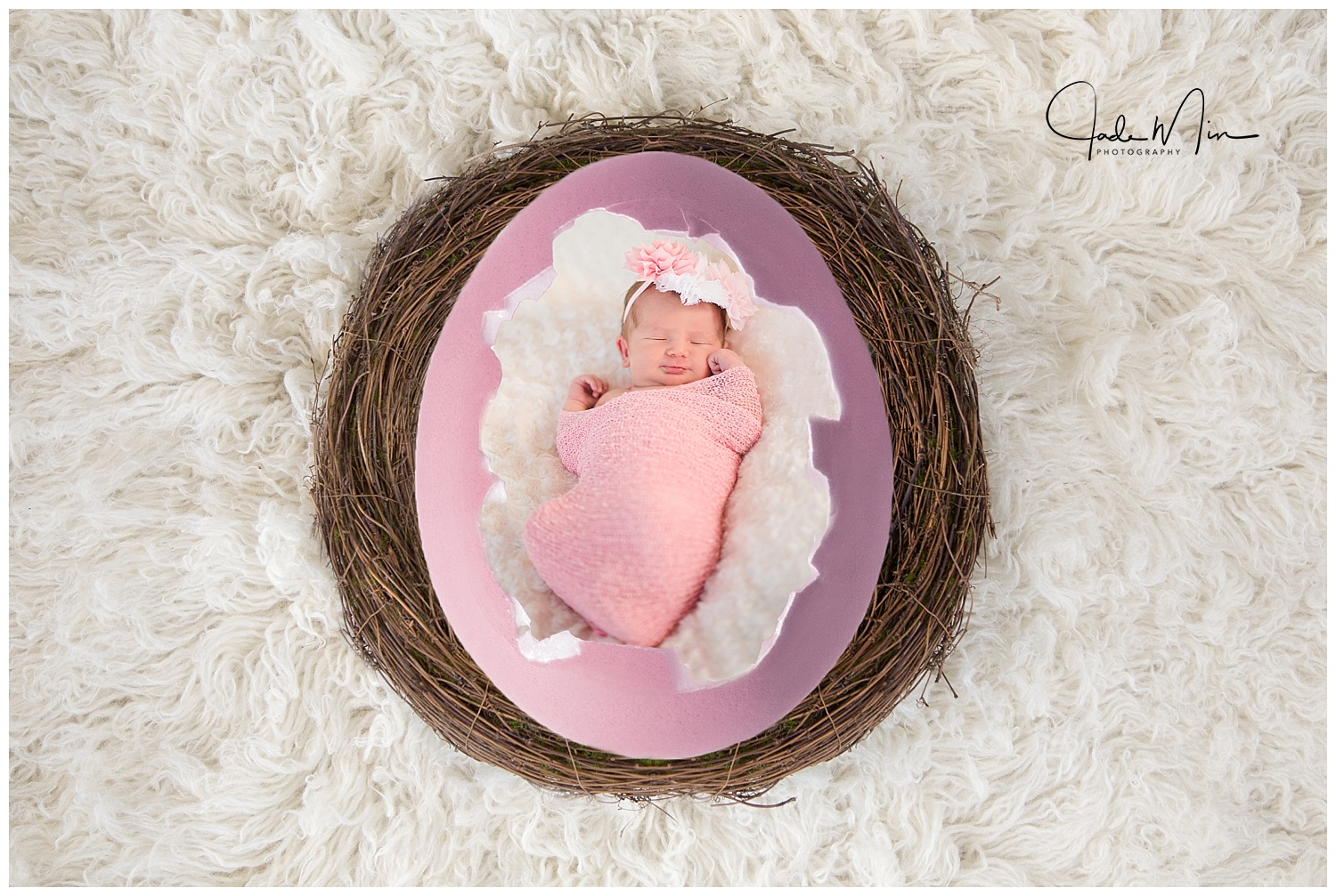 Baby Amelia's newborn session - this depicts her hatching out of an egg - isn't she adorable?