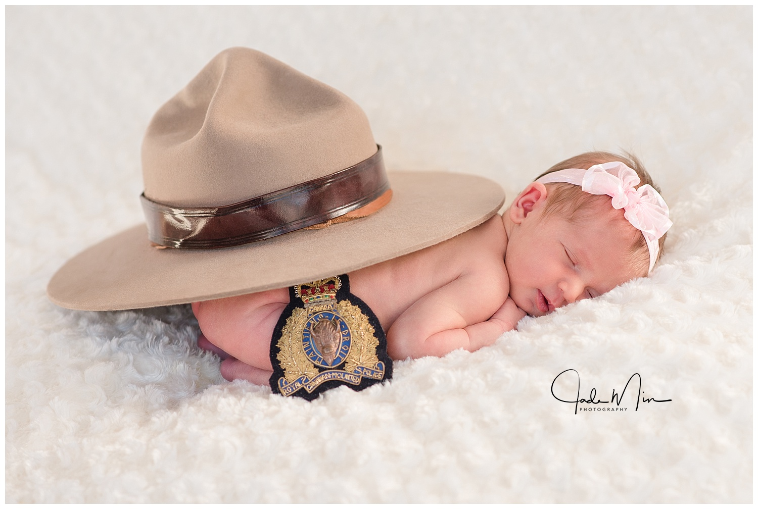 The hat and badge pictured here belongs to Crista's beloved mother, Kimberley Shaughan Hall Bronson, who passed away in 2016. She was a sergeant in the Royal Canadian Mounted Police Department and was very respected in her community and loved by many. Emilia looks so peaceful here, and I can imagine that her grandmother was showering her with angel lullabies.