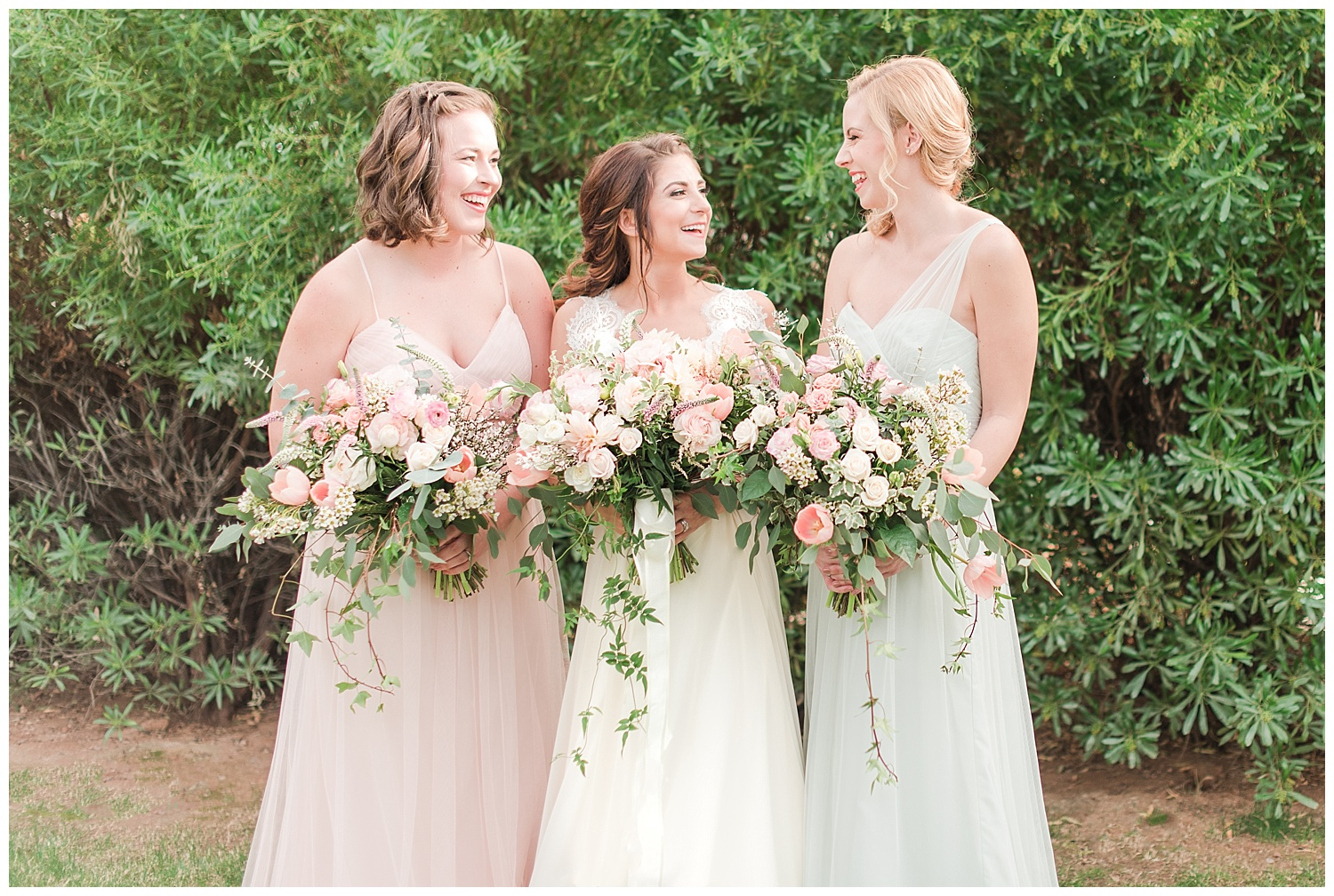 Bridesmaids and bride Jessica wearing dresses provided by Bella Lily Bridal in Phoenix and holding bouquets made with love by Garden Gate Flowers, photographed at Gather Estate in Mesa, Arizona.