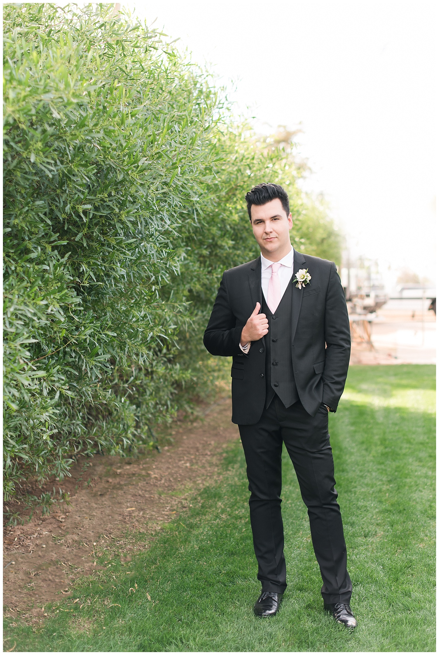 Groom Slaven wearing his own fitted and dashing suit, photographed at Gather Estate in Mesa, Arizona.