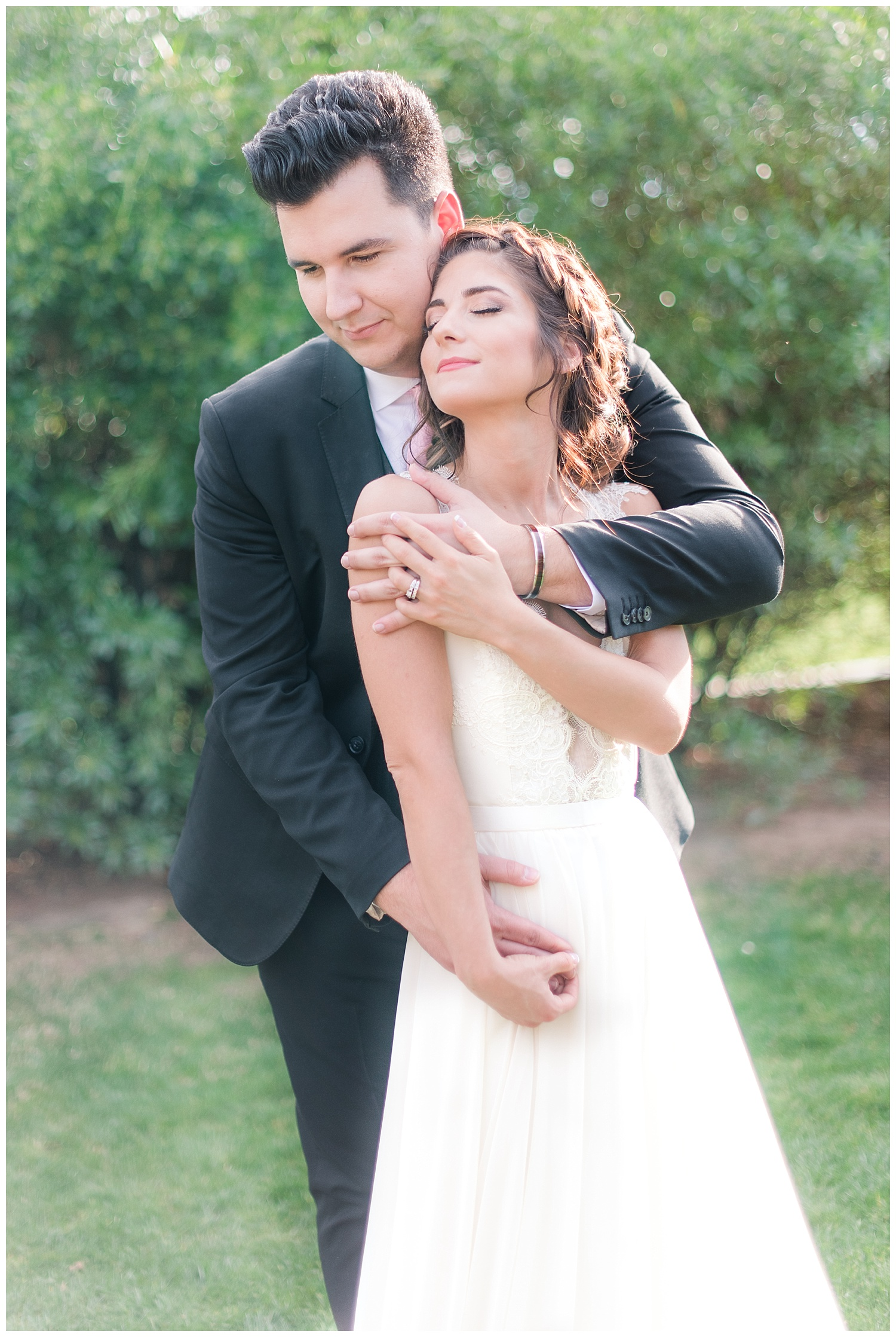 Bride Jessica wearing dress provided by Bella Lily Bridal in Phoenix and being held by groom Slaven, photographed at Gather Estate in Mesa, Arizona.