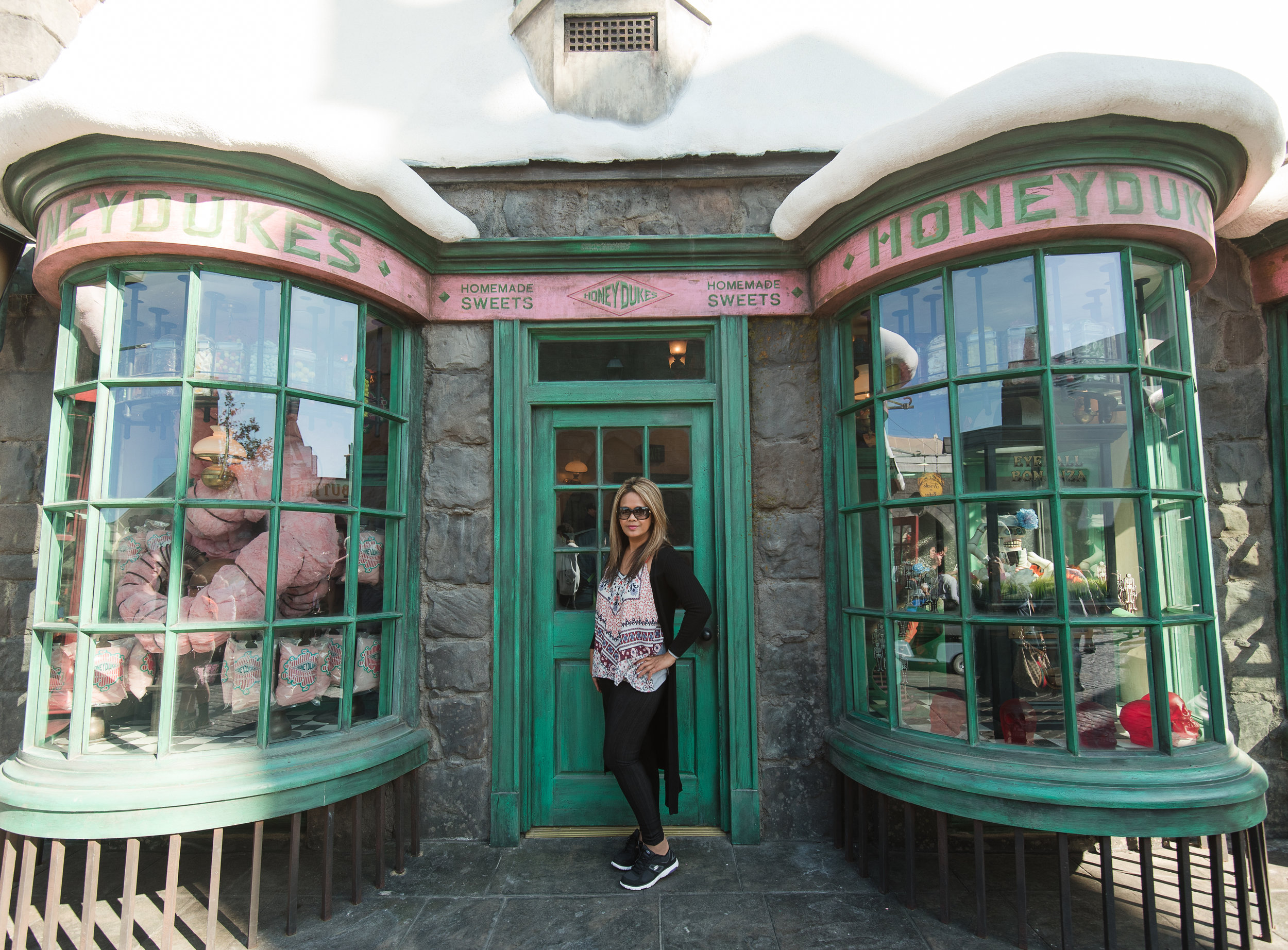 Owner of Jade Min Photography posing in front of Honeydukes at Harry Potter World, Universal Studios Hollywood.
