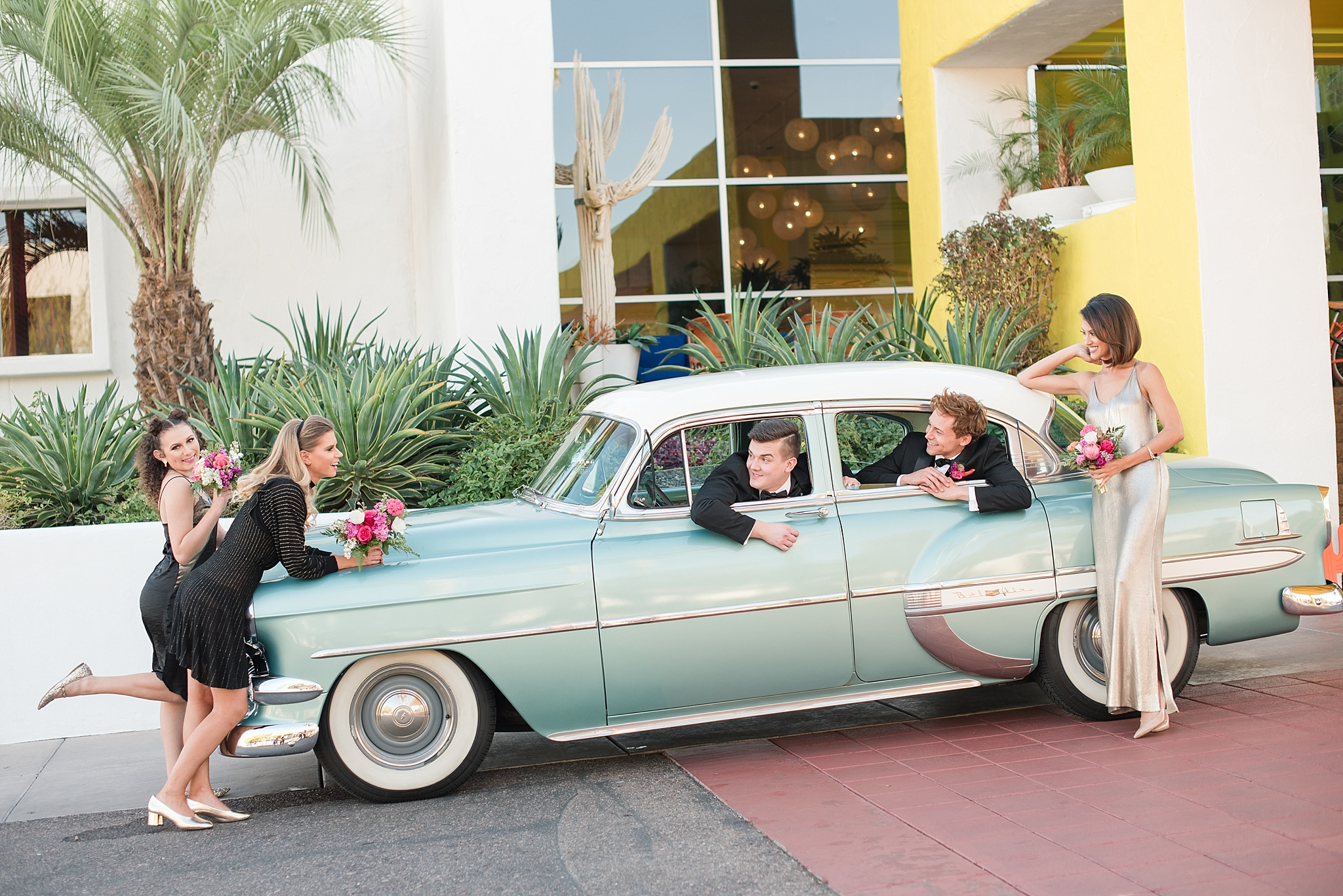Vintage car provided by Roscoe + Louie. Bridesmaids wearing fashions by Zara, hair and makeup done by Makiaj Beauty, and jewelry by @francesvintage. Groom models Zach Jones & Seth Powers wearing tuxes provided by Celebrity Tux & Tails. Photos taking by Jade Min Photography at The Saguaro Scottsdale.