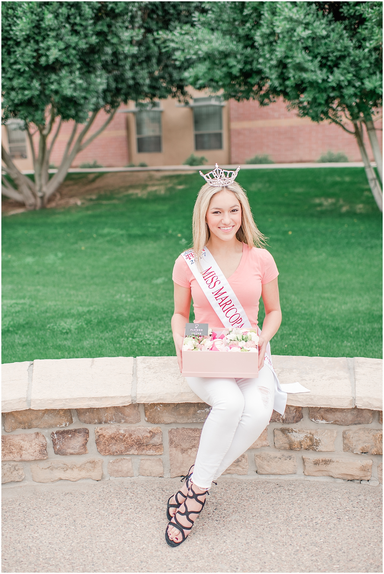 Beautiful box filled with an arrangement of lovely flowers and delicious French macarons made with love by Flower from Lower, and held by Miss Maricopa's Outstanding Teen Ela Wootton. Photo taken by Jade Min Photography.