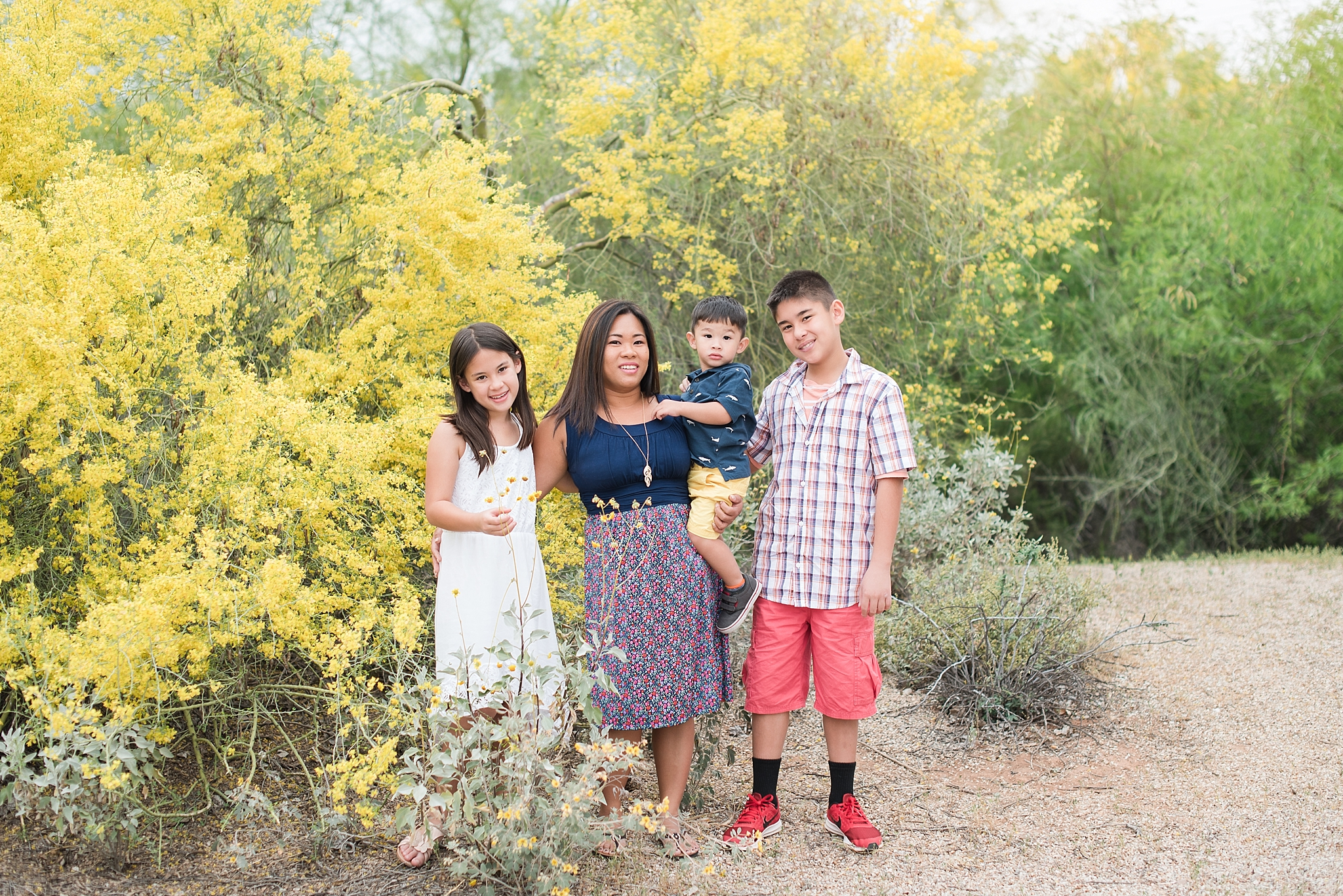 Family photography session with Jhenneil Cruz and her kids, Greyson, Kaelin, and Mithchell. Photos taken at Gilbert Riparian Preserve by Jade Min Photography.