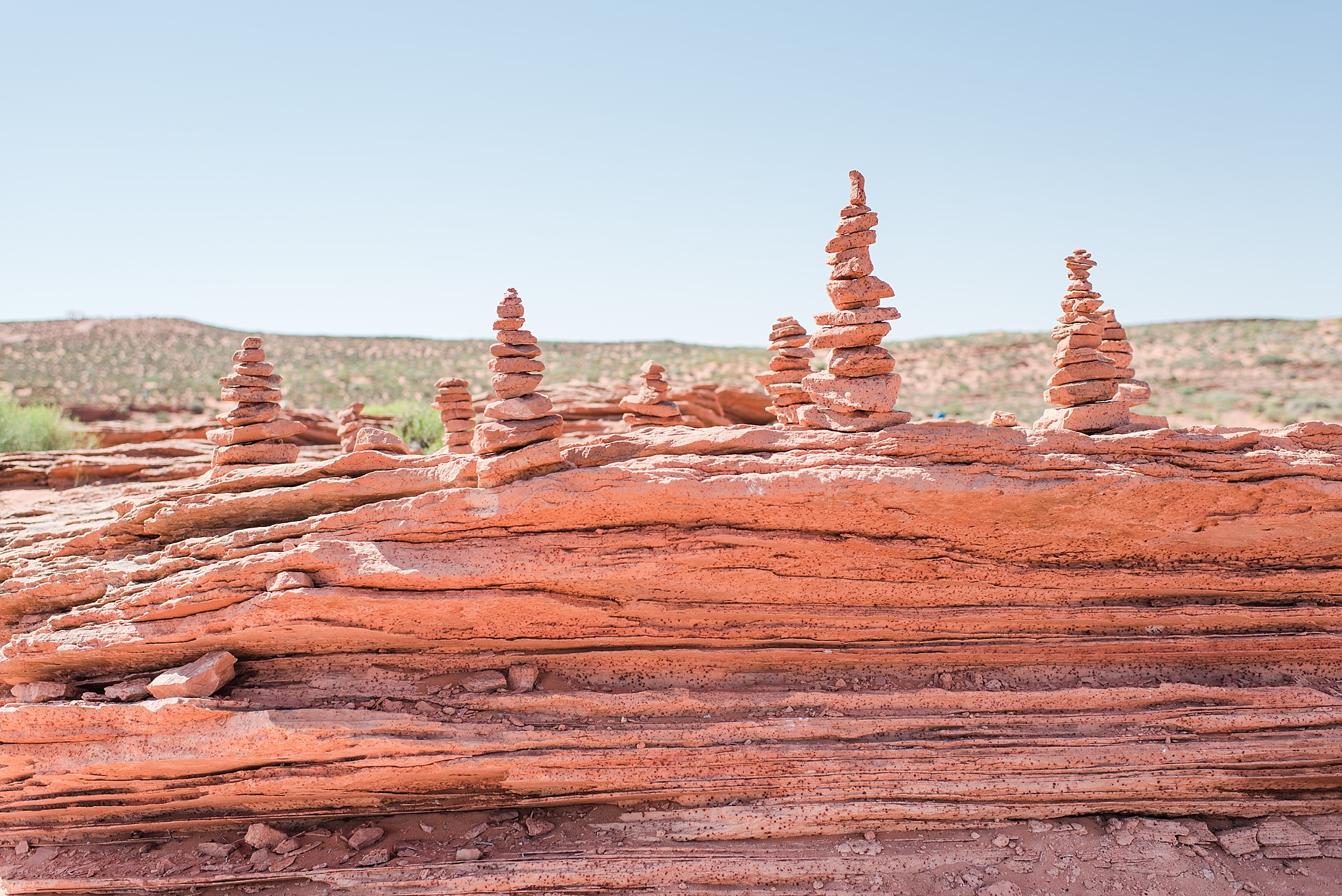 Rock formations at Horseshoe Bend site near Page, Arizona. Travel photo by Jade Min Photography.