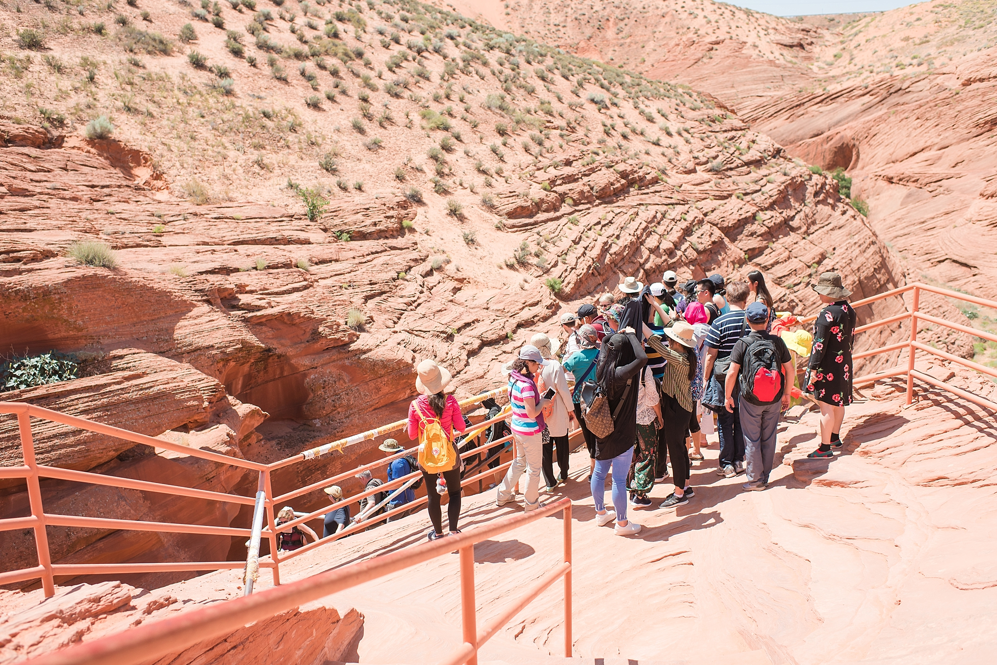 The line to climb down into Lower Antelope Canyon, near Page, Arizona. Photo by Jade Min Photography.