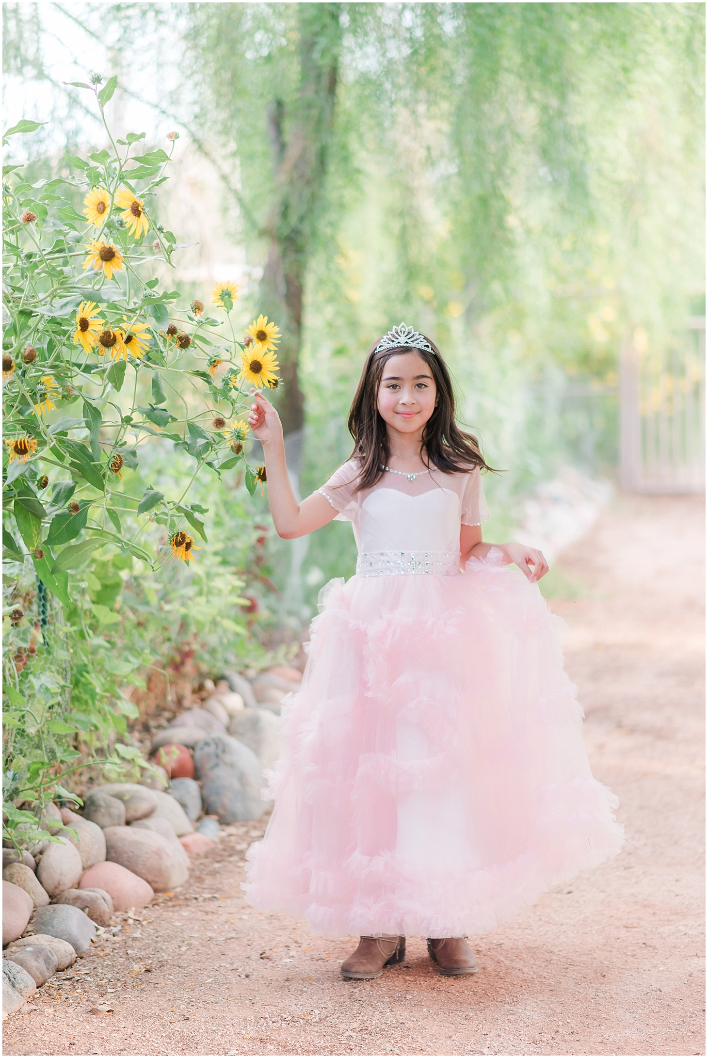 I had Sydney model one of the dresses and tiaras available for rent through Jade Min Photography. I love that she wore cowboy boots with the dress! Isn't she a gorgeous child?