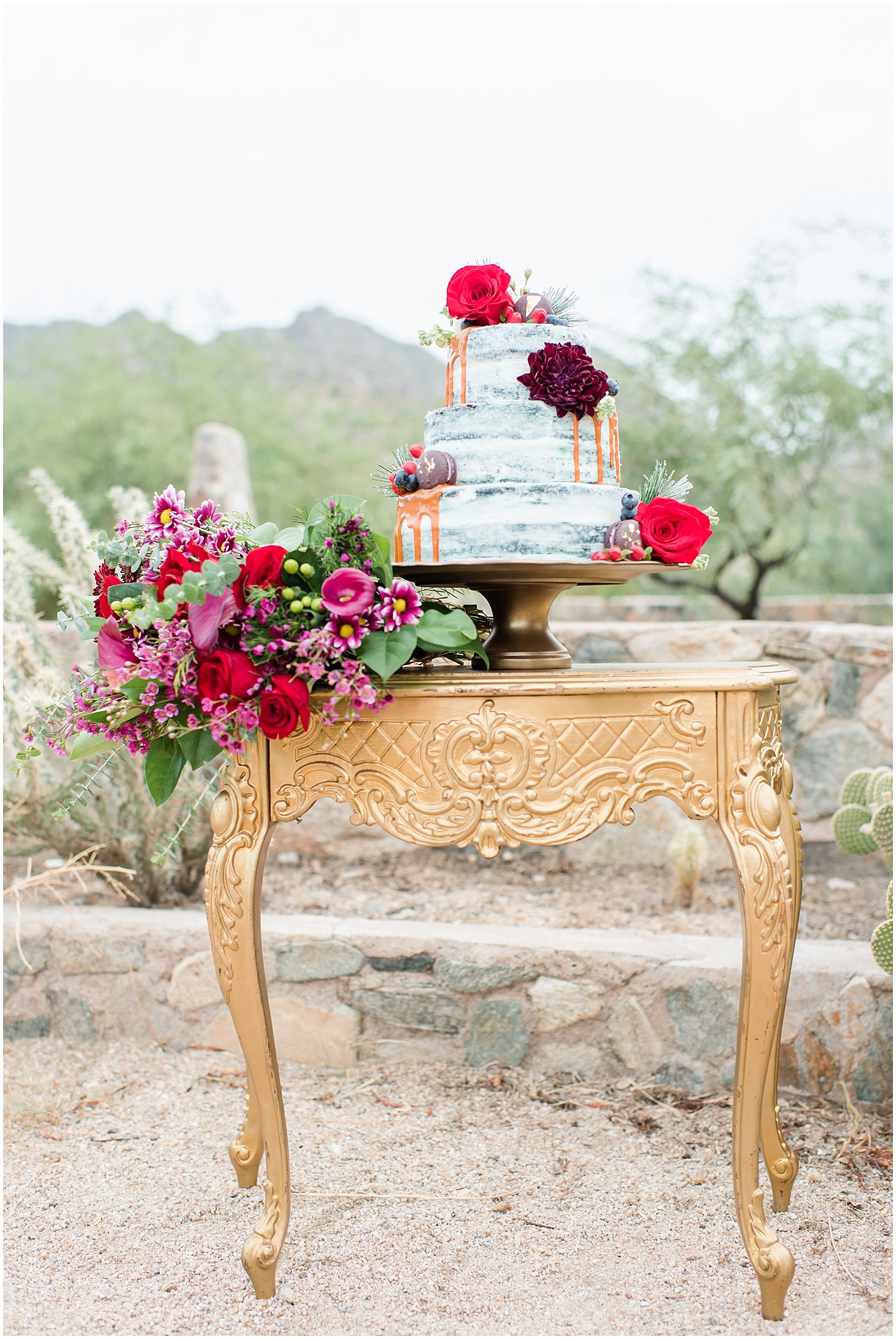 Amazing wedding cake made by Antigo Cakes displayed on a table provided by Material Girls Weddings, and a vibrant bouquet! Photos taken by Phoenix wedding photographer, Jade Min Photography.